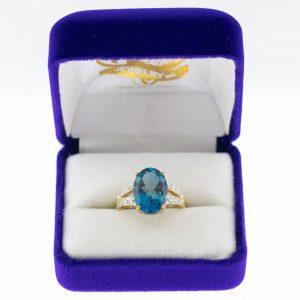 Athena ring yellow gold blue topaz diamond front view