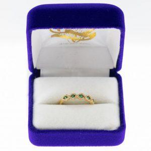 Athena ring yellow gold emerald diamond front view